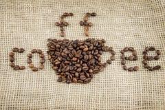在麻袋布的咖啡豆 库存照片