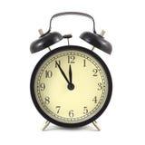 在黑被隔绝的盒和米黄clockface的闹钟紧密  免版税库存照片
