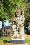 在黑议院的巨型雕象巴厘岛猪圈 库存照片