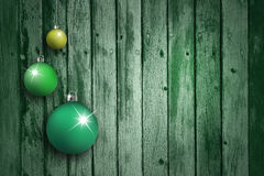 在年迈的木背景设置的绿色电灯泡 免版税库存照片