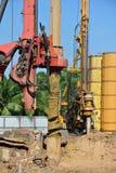 在建造场所使堆船具机器不耐烦 免版税库存图片