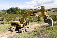 在建造场所的挖掘机 图库摄影
