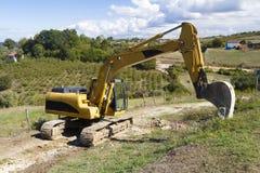 在建造场所的挖掘机 免版税图库摄影