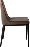 在黑金属腿的设计师棕色用餐的椅子 在白色背景隔绝的现代软的椅子 免版税库存照片