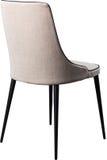 在黑金属腿的设计师灰色用餐的椅子 在白色背景隔绝的现代软的椅子 免版税库存照片