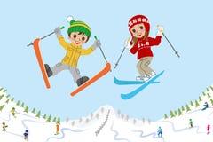 在滑雪倾斜的跳跃的孩子 库存照片