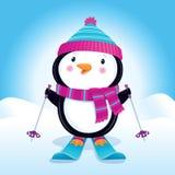 在滑雪的逗人喜爱的企鹅 免版税库存图片
