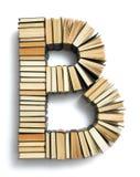 在从页结尾形成的B上写字的书 免版税库存图片