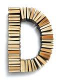 在从页结尾形成的D上写字的书 免版税库存图片