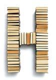 在从页结尾形成的H上写字的书 免版税库存照片