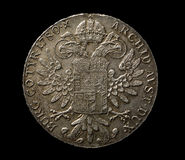 在黑顶视图的老银币 免版税库存图片