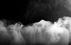 在黑颜色背景的雾或烟移动 库存照片