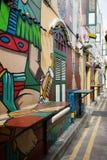 在赴麦加朝圣过的伊斯兰教徒车道的街道画在新加坡 免版税图库摄影