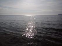 在水,亚庇,马来西亚的太阳 库存图片