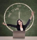 在2013年的愉快的女实业家赢取 免版税库存照片