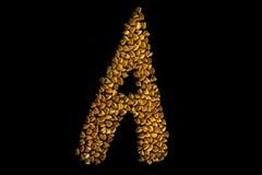 在A上写字写用荞麦在黑背景 免版税库存图片