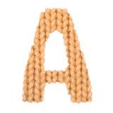 在A英语字母表,颜色桔子上写字 免版税库存照片