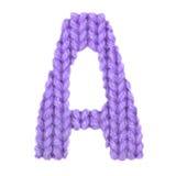 在A英语字母表,颜色紫色上写字 库存照片