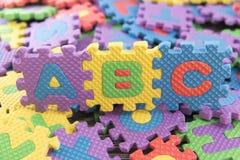 在abc上写字难题字母表 免版税库存照片