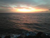 在Aguada波多黎各海滩的日落 免版税库存图片