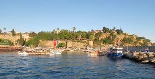 在Antalyas Oldtown港口在Kaleici区,土耳其的日落 免版税库存照片