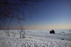 在ATV的冬天旅行 库存图片