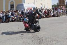 在ATV的危险特技托马斯加里宁 库存图片