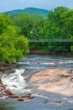 在Ausable河的一座走的桥梁 免版税图库摄影