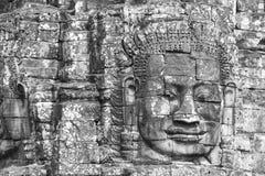 在Bayon寺庙,吴哥窟,柬埔寨的石面孔 免版税库存图片