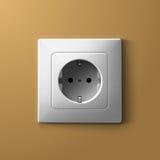 在biege墙壁上的现实电白色插口 免版税图库摄影