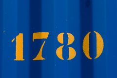 1780在bluw钢片的黄色字体 库存照片