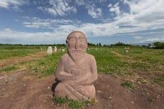 在Burana的雕塑,在吉尔吉斯斯坦 图库摄影