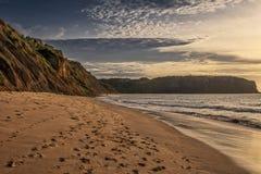 在Cabo Ledo海滩的美好的日落 安格斯 闹事 库存图片