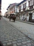 在calle crisologo的kalesa 免版税库存照片