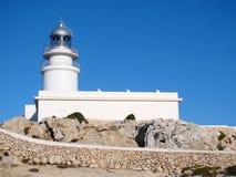 在Cap de Cavalleria, Menorca的灯塔 免版税库存图片