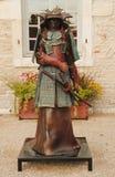 在Chateau de Pommard w前面的古铜色雕象  图库摄影