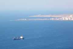 在Chekka港口的货物红色船在黎巴嫩 免版税库存照片