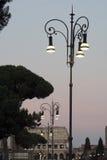 在colosseum附近的一盏灯 免版税库存照片