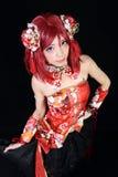 在cosplay服装打扮的年轻亚裔女孩 免版税库存照片