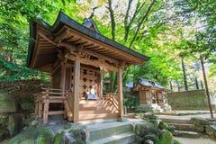 在Dazaifu Tenmangu的一座小木寺庙 库存图片