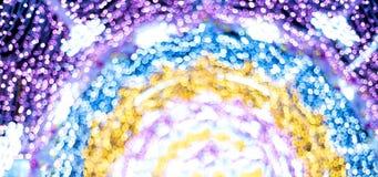 在defocus的抽象发光的圈子 库存照片