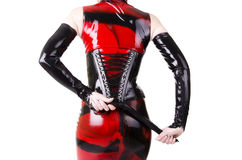 在dominatrix衣裳打扮的妇女 免版税库存图片