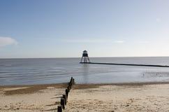 在Dovercourt艾塞克斯的灯塔有海滩的 免版税图库摄影