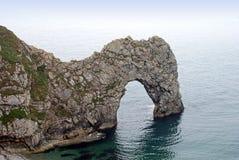 在Durdle门多西特英国英国的自然沿海石曲拱 库存图片