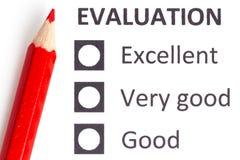 在evaluationform的红色铅笔 库存照片