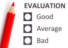 在evaluationform的红色铅笔 库存图片