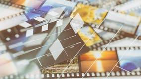 在filmstrips的Clapperboard 免版税库存图片