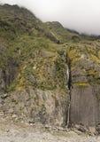 在Fox冰川附近的瀑布在新西兰 库存图片