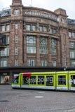 在Galeries拉斐特前面的电车在史特拉斯堡,法国 库存照片