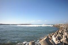 在Glagah海滩的防堤 库存图片